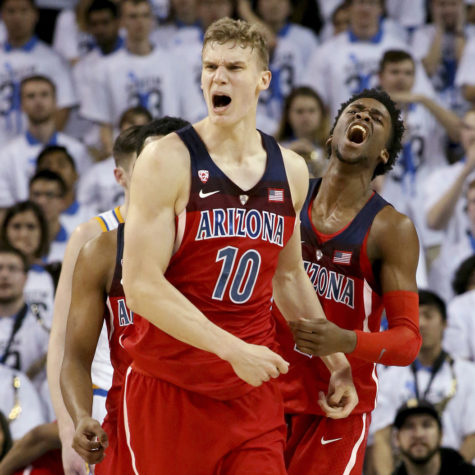 Arizona's Lauri Markkanen (10) celebrates with teammate Kobi Simmons after a dunk against UCLA late in the second half on Saturday, Jan. 21, 2017, at Pauley Pavilion in Los Angeles. Arizona won, 96-85. (Luis Sinco/Los Angeles Times/TNS)