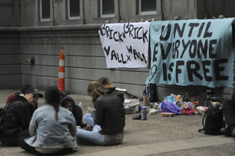 Protestors sit outside the Alleghany County Jail Tuesday. Anna Bongardino | Staff Photographer