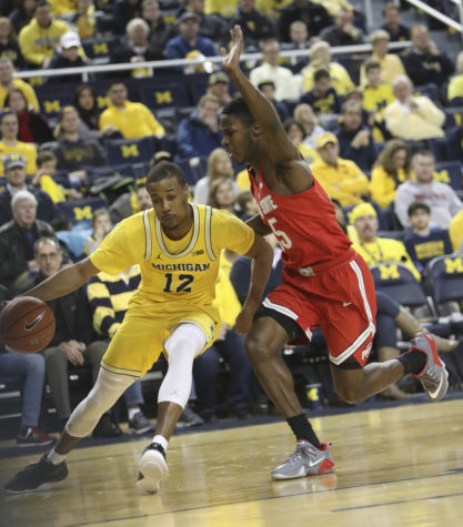 Michigan's Muhammad-Ali Abdur-Rahkman, left, drives against Ohio State's Kam Williams in the first half on Saturday, Feb. 4, 2017, at the Crisler Center in Ann Arbor, Michigan. Ohio State won, 70-66. (Kirthmon F. Dozier/Detroit Free Press/TNS)