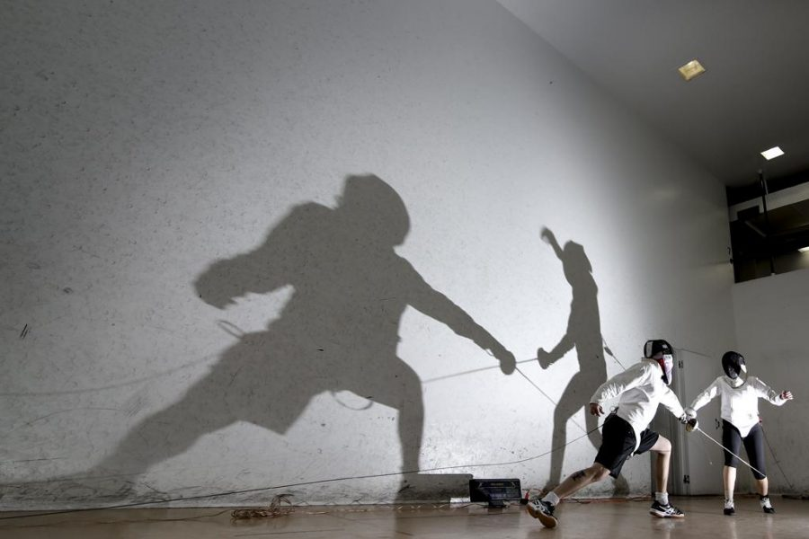 Theo Schwarz took 2nd place in the feature photo category for his photo of two fencers and their shadows.