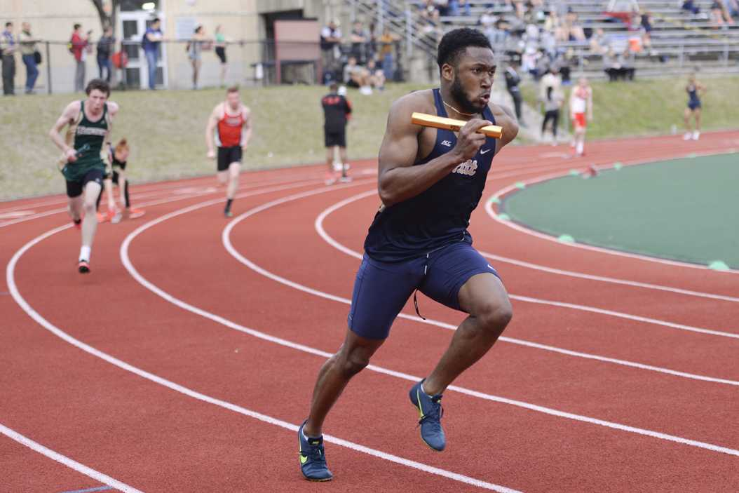 Jabari Michael-Khensu runs the lead leg of Pitt's stadium record-setting 41.52-second 4x100m relay. Anna Bongardino | Staff Photographer