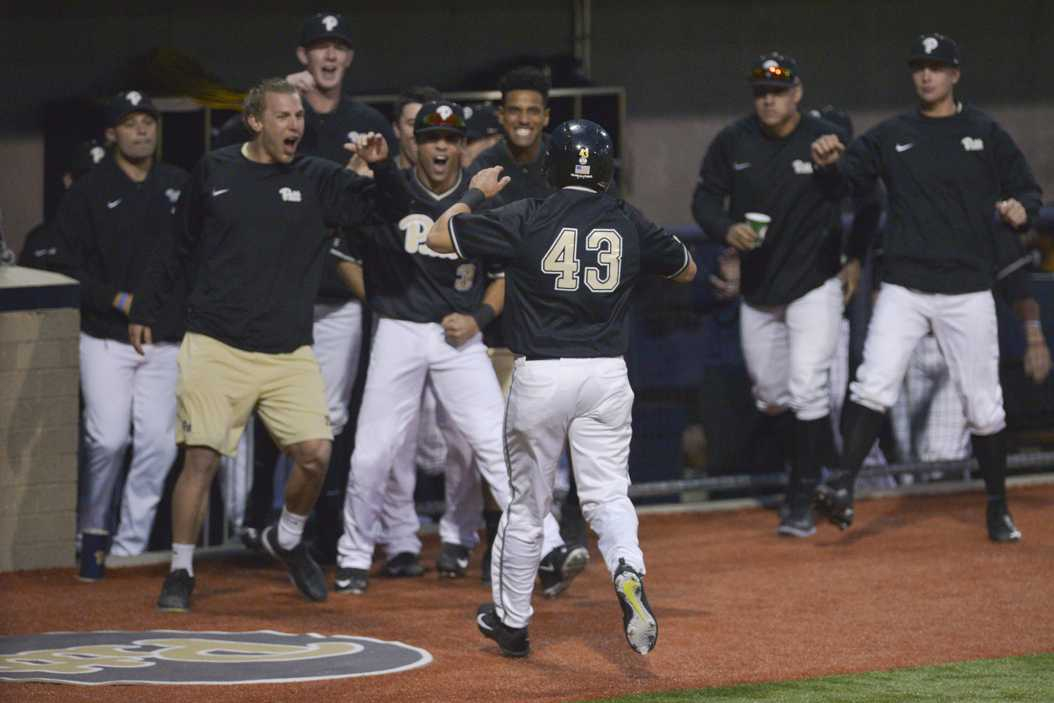 Pitt senior catcher Manny Pazos heads back to an excited dugout after scoring the go-ahead run during Pitt's 3-2 win over rival Penn State on April 4. Anna Bongardino | Staff Photographer