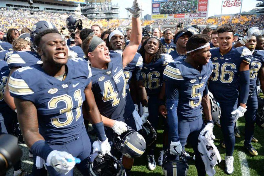 Members of the Pitt football team celebrate with the Panther Pitt after last year's win over Penn State. (TPN File Photo)