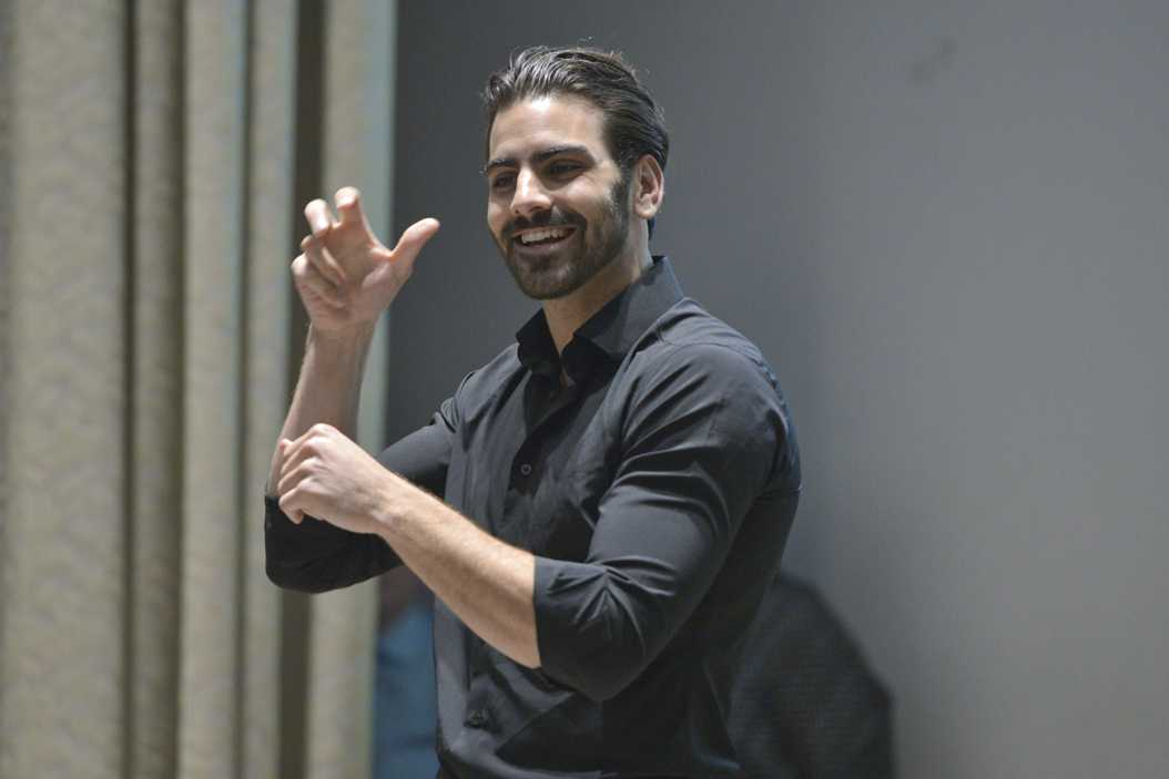 Nyle DiMarco, a deaf activist and model, advocatdes for the Deaf community and shares his life experiences on Monday at Frick Fine Arts. Meghan Sunners | Visual Editor