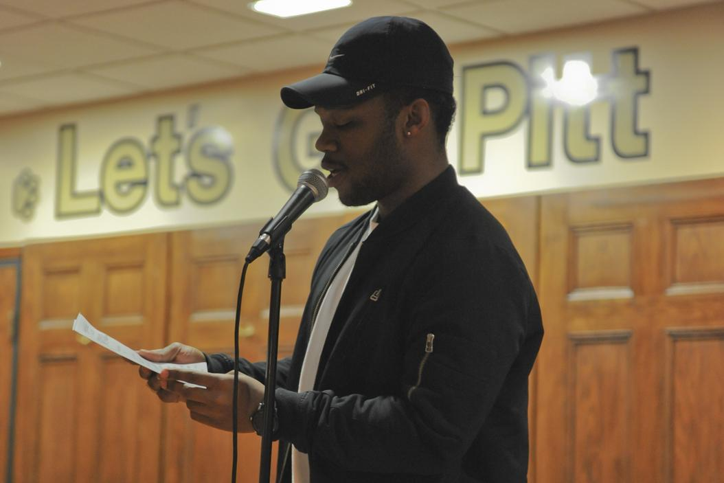 Kenyatta Bundy performs a poem he wrote during the Pitt Progressives' open mic night in Nordy's Place on March 29. Elaina Zachos | Senior Staff Photographer