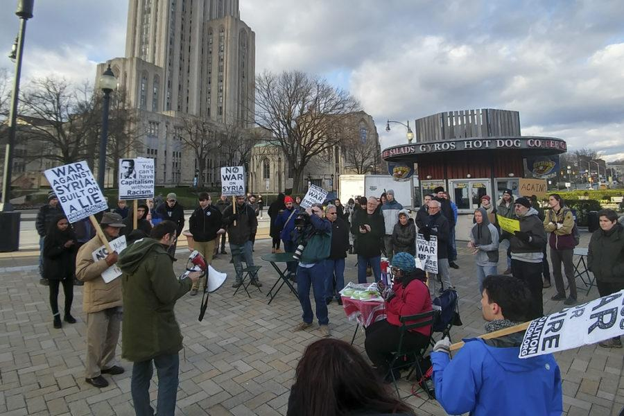 Oakland+residents+protest+the+military+strike+on+Syria+at+Schenley+Plaza+on+Friday.+Stephen+Caruso+%7C+Assistant+Visual+Editor