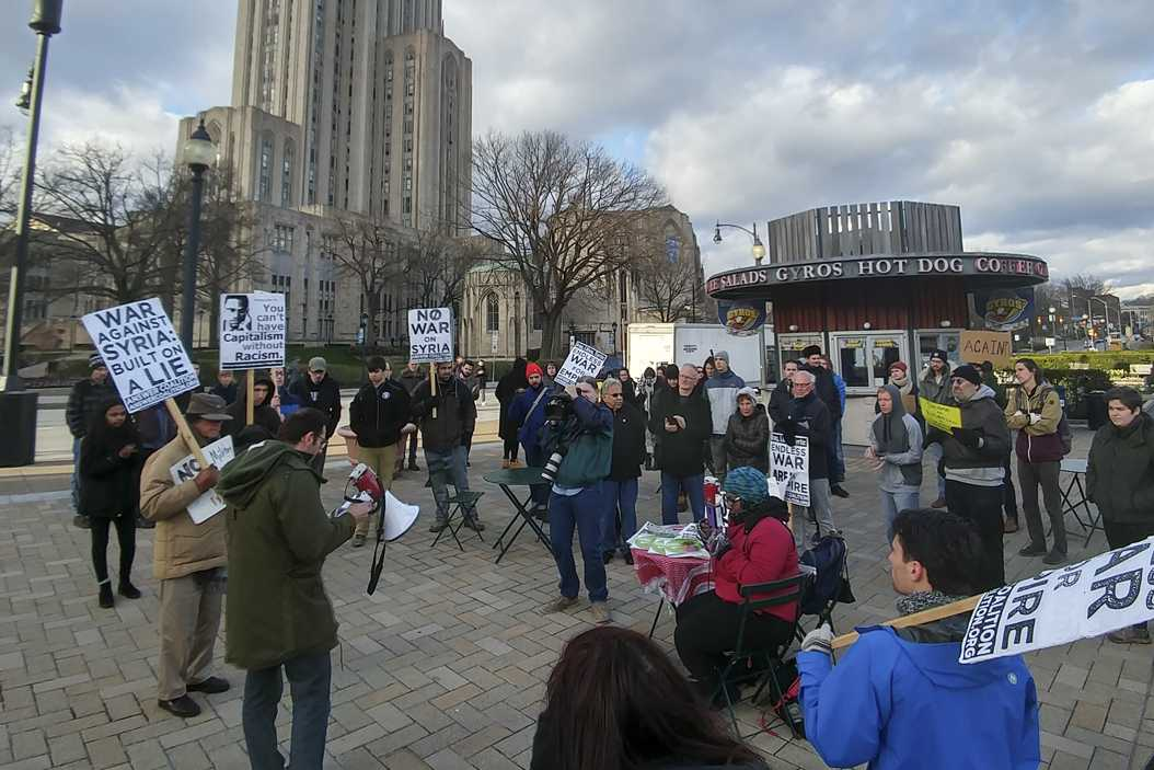 Oakland residents protest the military strike on Syria at Schenley Plaza on Friday. Stephen Caruso | Assistant Visual Editor