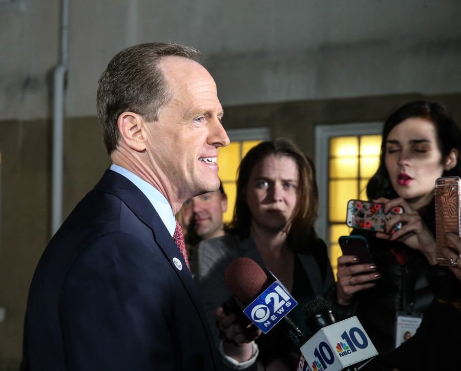 Sen. Pat Toomey talks with the media after voting for president Nov. 8, 2016. Toomey voted to confim DeVos as education secretary on Tuesday. Steven M. Falk/Philadelphia Inquirer/TNS