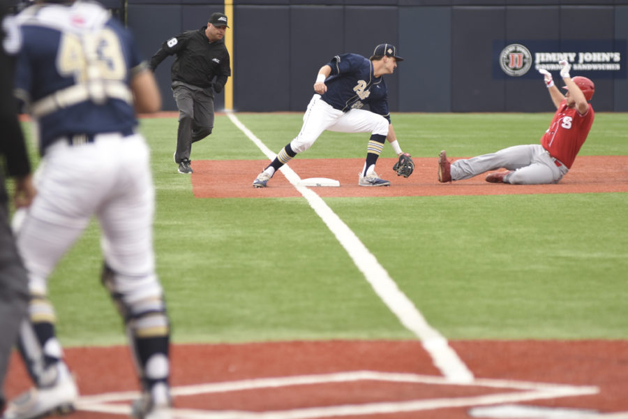 Junior Nick Banman tags out a Wolfpack runner in Pitt's 7-4 loss Friday night. Matt Hawley | Staff Photographer