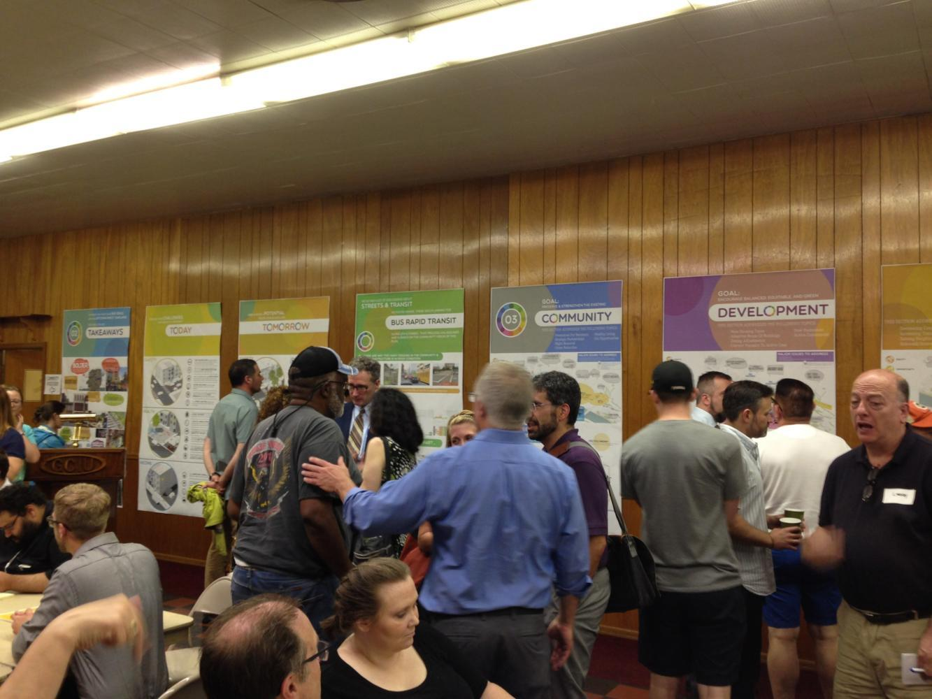 Attendees of the EcoInnovation meeting on Tuesday night learn more information about the project by reading poster boards. (Photo by Henry Glitz | Contributing Editor)