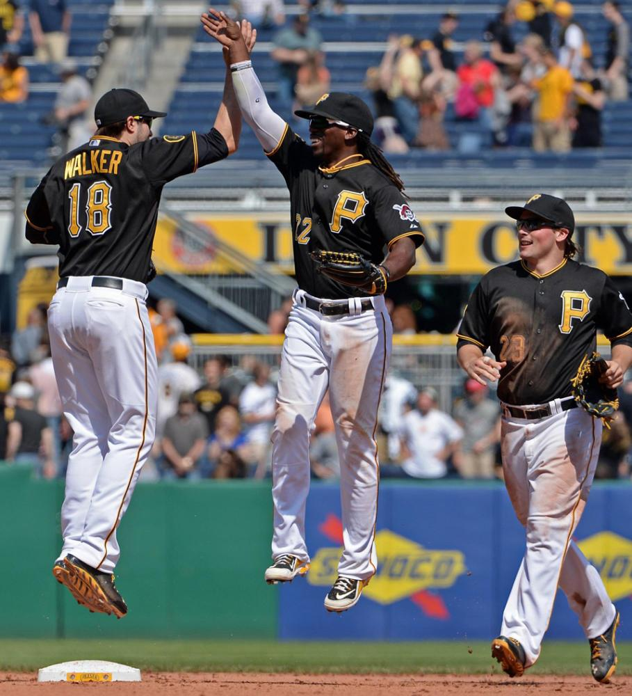 Andrew McCutchen celebrates with Travis Snider after the team's 4-3 victory over the San Francisco Giants in May 2014. (Matt Freed/Pittsburgh Post-Gazette/MCT)