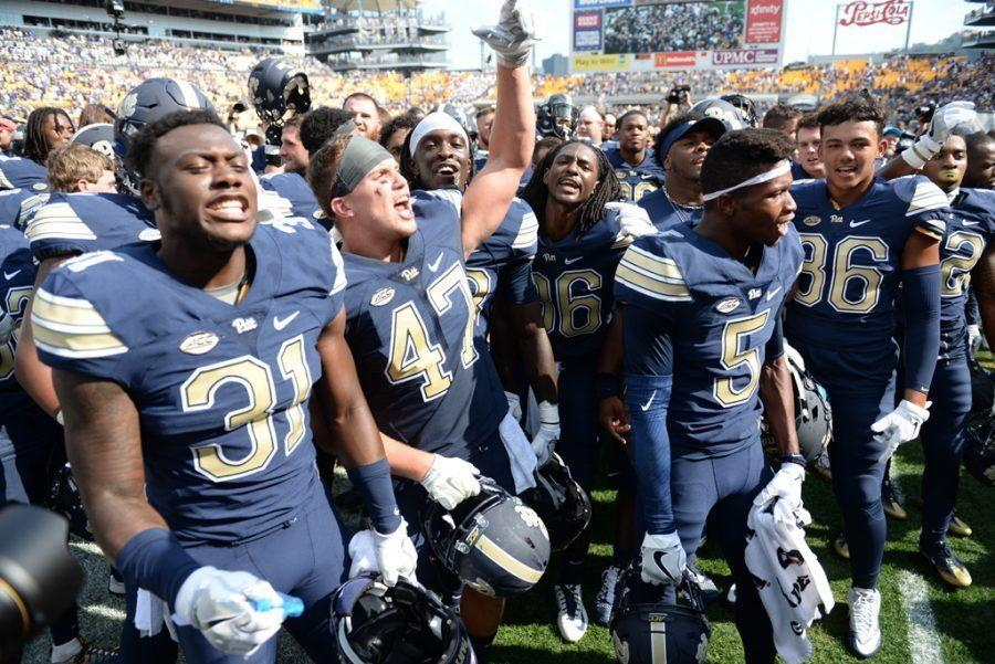 Matt Galambos (47) celebrates with teammates after the Panthers' 42-39 win over Penn State Sept. 10. TPN File Photo
