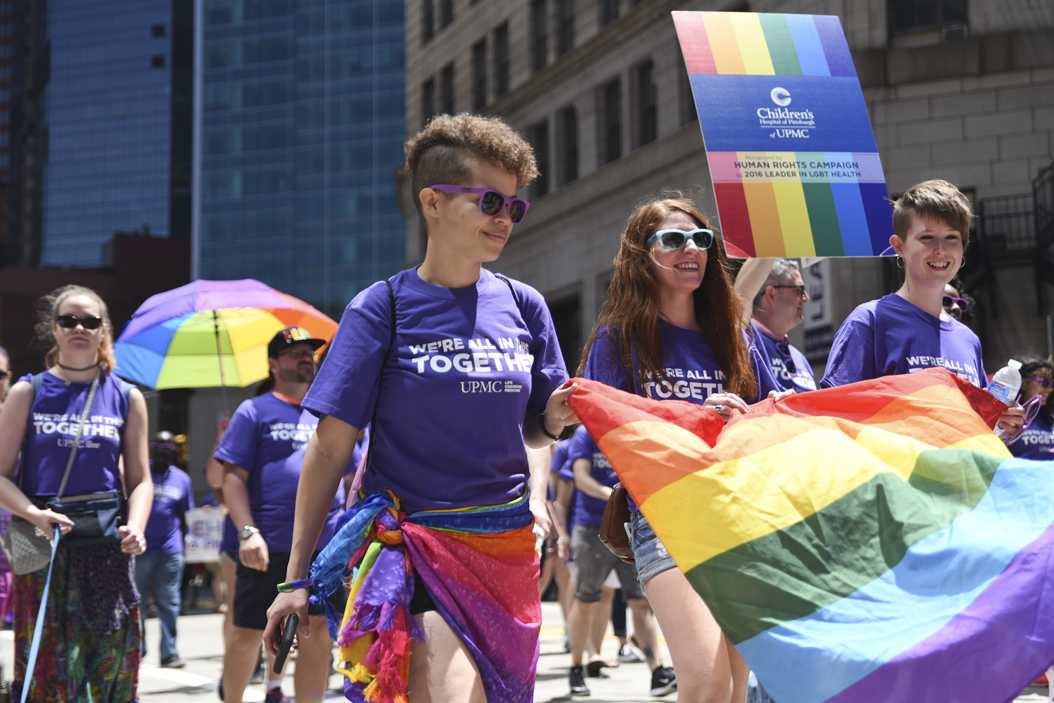 People march in affiliation with UPMC at last year's Pride celebration. (Photo by Matt Hawley | Staff Photographer)