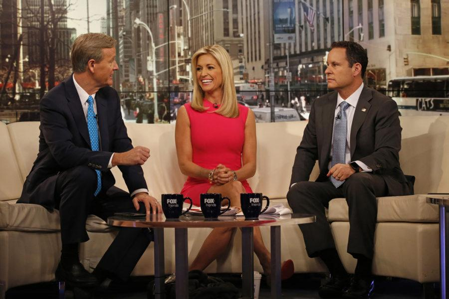 Steve Doocy, Ainsley Earhardt and Brian Kilmeade film a segment of