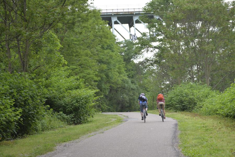 Bikers ride along a path in Schenley Park. (Photo by Anna Bongardino | Visual Editor)