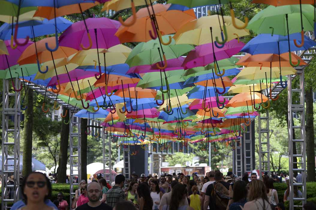 The Umbrella Sky Project, developed in Portugal by the creative agency Sextafiera Producoes, is featured in the center of strings of vendors at the Three River Arts Festival on June 4. (Photo by Anna Bongardino | Visual Editor)