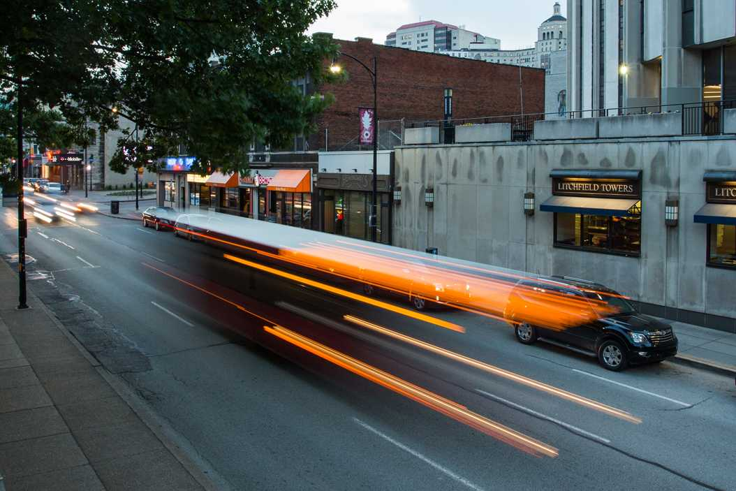 A bus passes by Towers on Forbes Avenue. (Photo by John Hamilton | Editor-In-Chief)