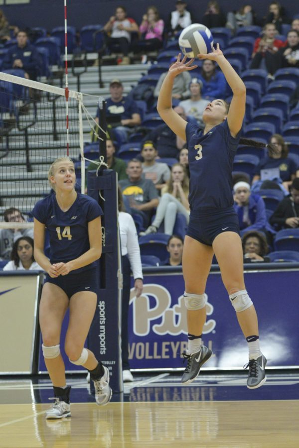 Kamalani Akeo (3) sets teammate Jenna Potts in a match at Fitzgerald Field House last season. (TPN File Photo)