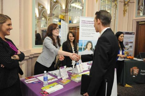 Pitt students network with UPMC recruiters at the 2014 Spring Career Fair.  (TPN File Photo)