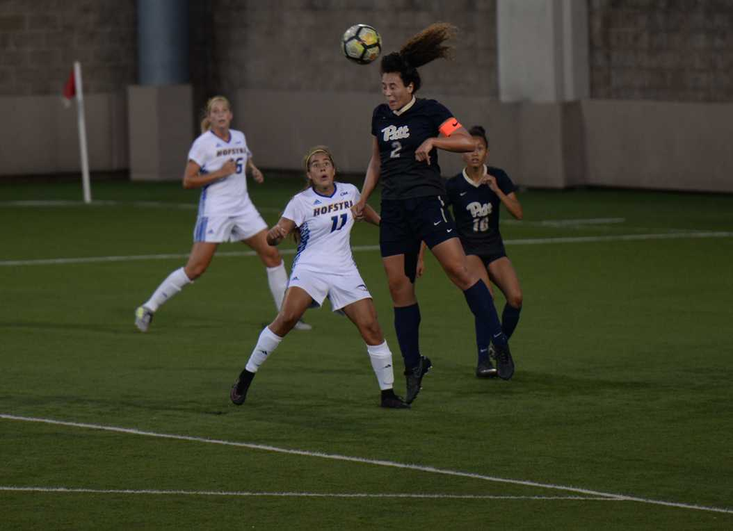 Pitt senior Emma Pozzulo (2) heads the ball out of danger in the team's Friday night win over Hofstra. (Photo by Anna Bongardino | Visual Editor)
