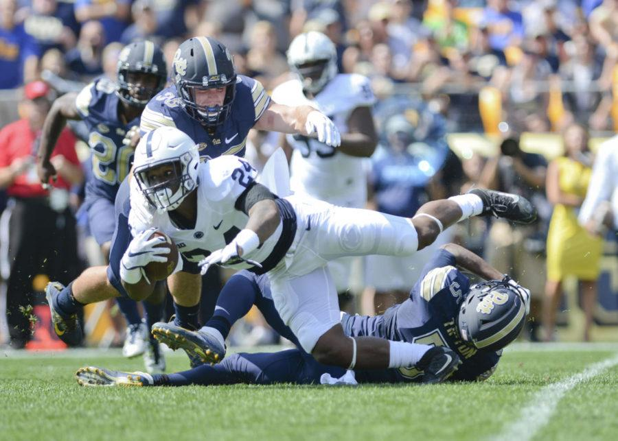 Pitt%27s+Tre+Tipton+%285%29+and+George+Aston+%2835%29+tackle+Nittany+Lions+running+back+Miles+Sanders+during+the+Panthers%27+42-39+win+last+season.+%28Photo+by+John+Hamilton+%7C+Managing+Editor%29