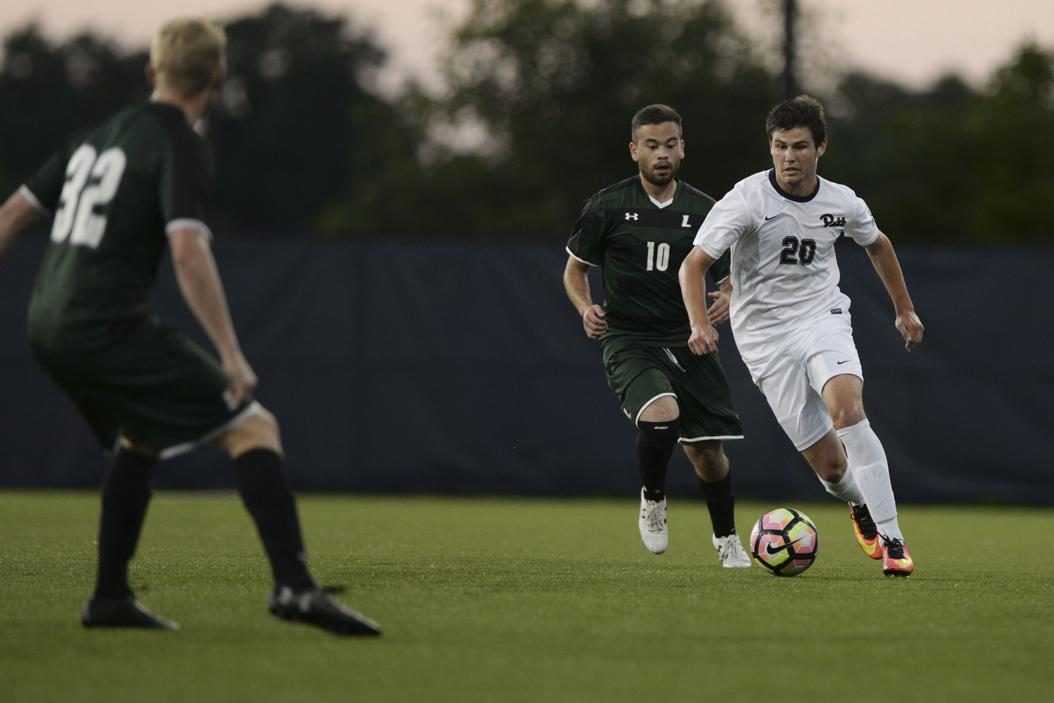 Junior midfielder Alec Anselmo dribbles the ball in Pitt's 2-1 overtime loss to Loyola last season. (Photo by John Hamilton | Managing Editor)