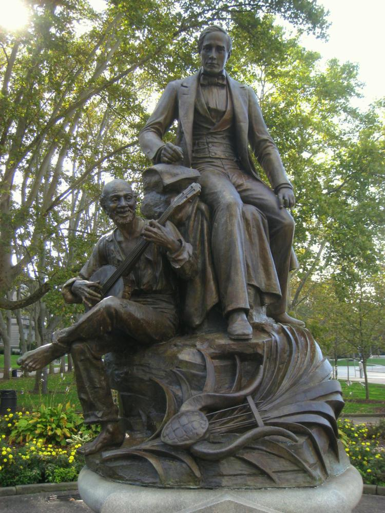 Violence in Charlottesville sparked a debate about Pittsburgh's own racially charged statue, the Stephen Foster statue in Oakland. (Photo via Wikimedia Commons)