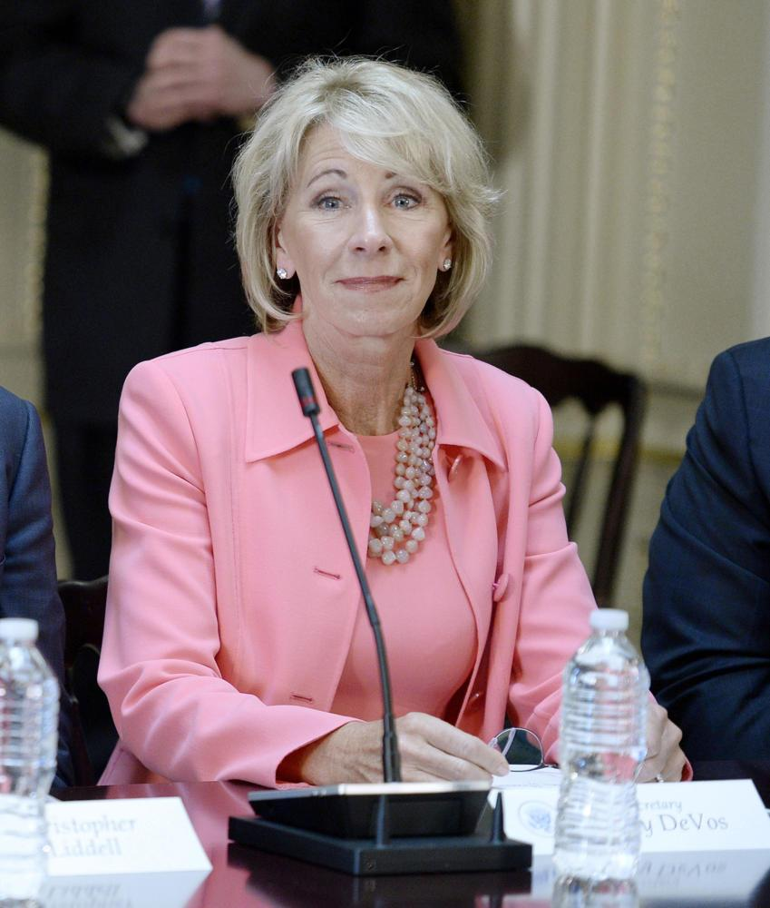 Education Sec. Betsy DeVos listens during a meeting with President Donald Trump in April 11. (Olivier Douliery/Abaca Press/TNS)
