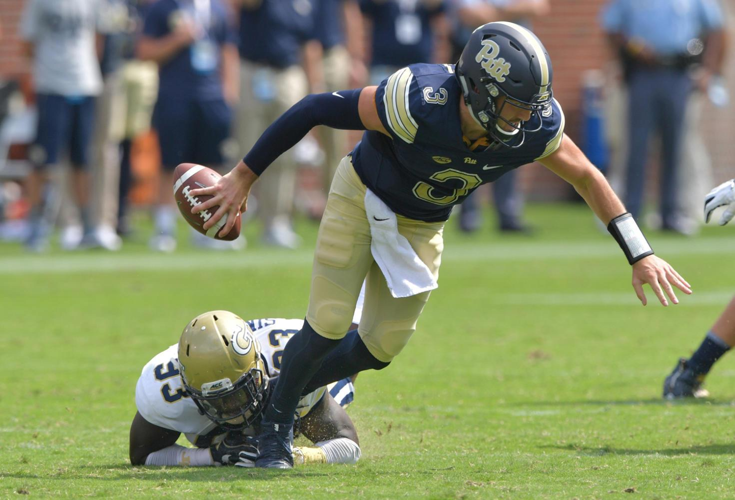 Pittsburgh quarterback Ben Dinucci (3) gets tackled by Georgia Tech defensive lineman Antonio Simmons (93) in the second half of Georgia Tech's 35-17 victory over Pitt. (Hyosub Shin/Atlanta Journal-Constitution/TNS)
