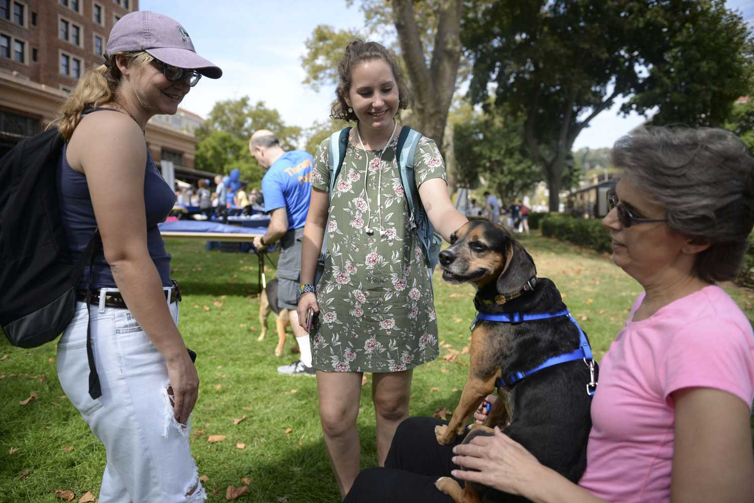 Lisa Farzee attends the Healthy U Fair with her therapy dog, Max. (Photo by Elise Lavallee | Contributing Editor)