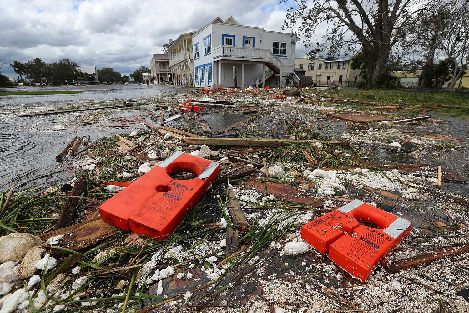 Life jackets for an adult and a child from the remains of the old Cumberland Queen Ferry, which sank, are part of the debris littering the flooded main street after Hurricane Irma swept through the area on Monday, Sept. 11, 2017, in St. Marys, Ga. (Curtis Compton/Atlanta Journal-Constitution/TNS)
