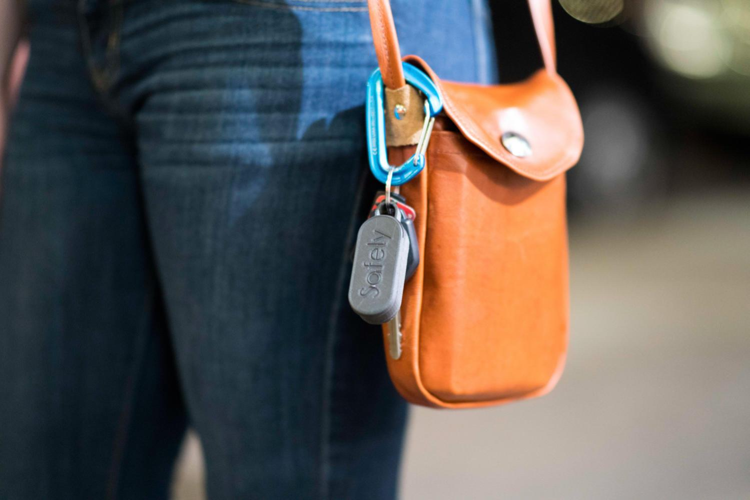 GoSafely, a wearable device that can be automated to make emergency calls, is attached to a bag as a keychain. (Photo courtesy of Koby Schmetterling)