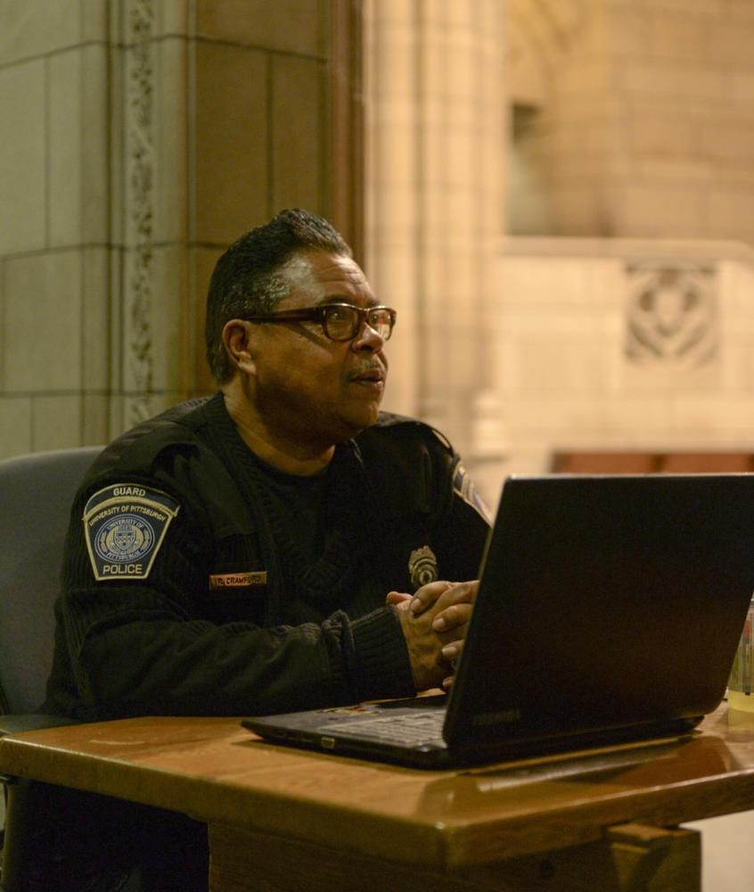 Russell Crawford, a security guard at the Cathedral of Learning, keeps the Cathedral safe at night. (Photo by Wenhao Wu | Assistant Visual Editor)
