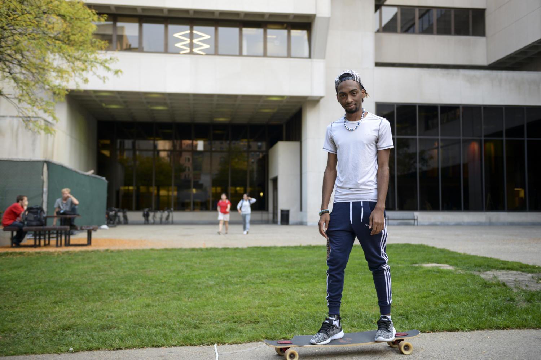 Robert Benjamin, a Pitt Biology graduate, still rides his longboard around Oakland. (Photo by Wenhao Wu | Assistant Visual Editor)