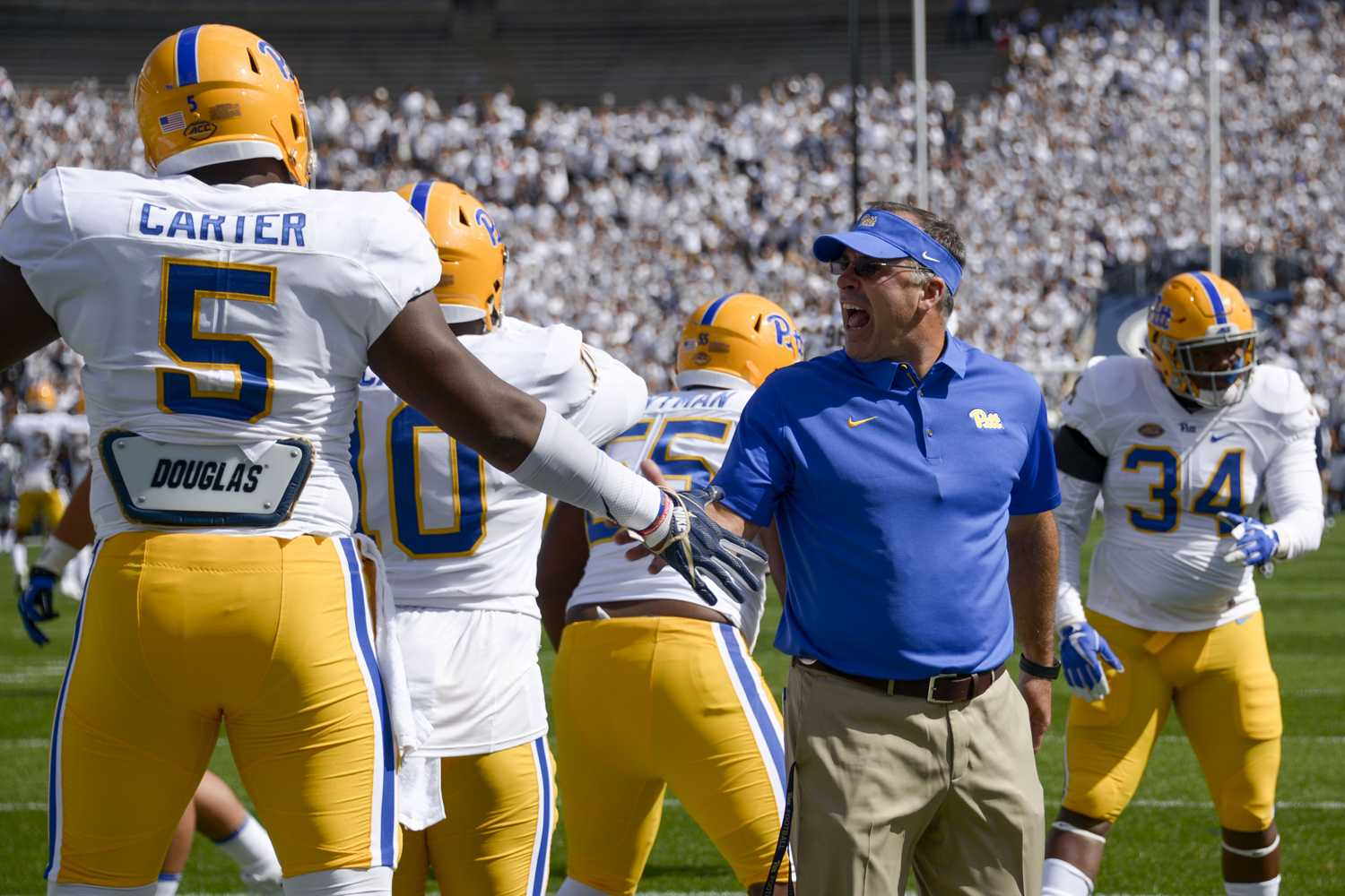 Coach Narduzzi encourages players during Pitt's game against Penn State Sept. 9. (Photo by Wenhao Wu | Assistant Visual Editor)