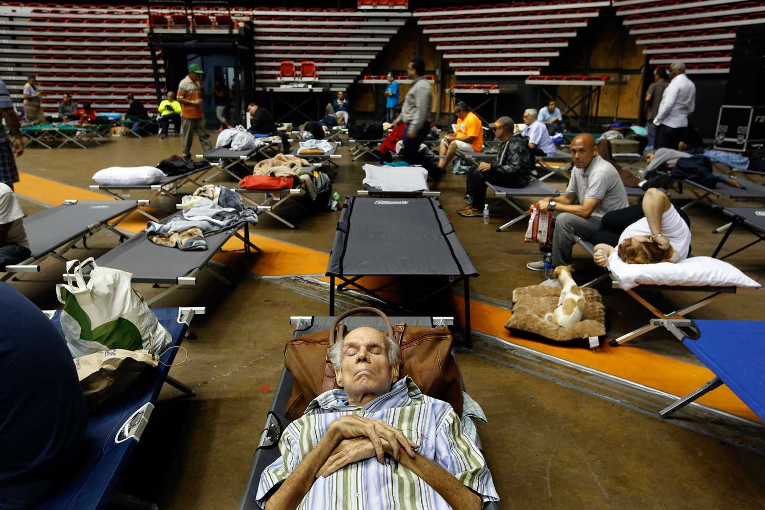 Hundreds of San Juan residents have taken shelter at the Roberto Clemente Coliseum in San Juan, Puerto Rico, on Tuesday, Sept. 19, 2017, until Hurricane Maria passes. (Carolyn Cole/Los Angeles Times/TNS)