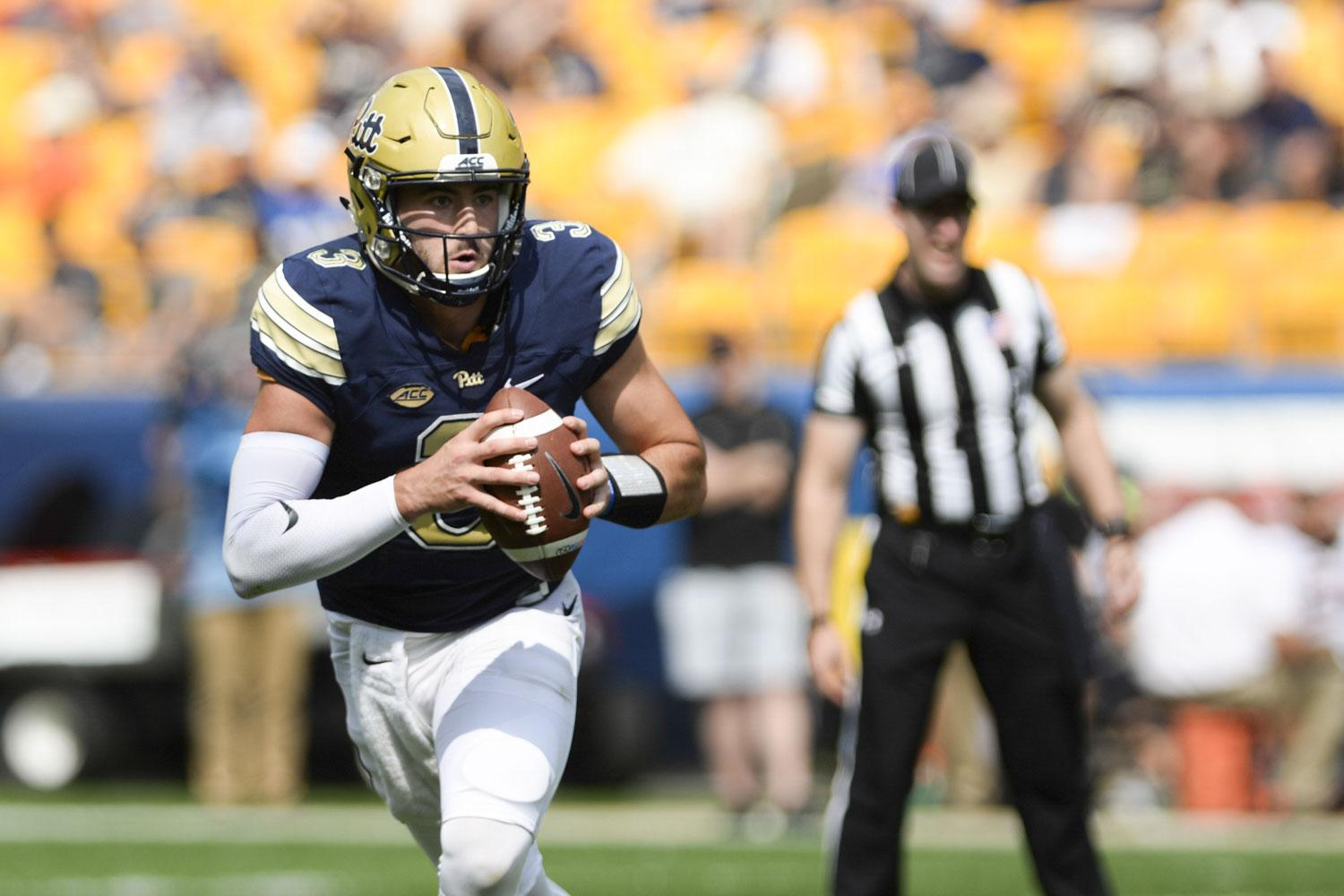 Quarterback Ben DiNucci scrambles in the second half of the game against Oklahoma State University.  (Photo by Kyleen Considine | Visual Editor)