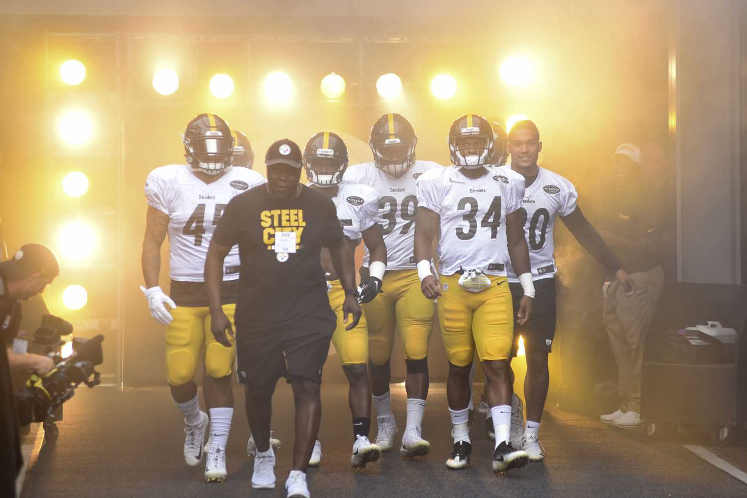 Steelers players walk onto the field during a practice in August. (Photo by Matt Hawley | Staff Photographer)