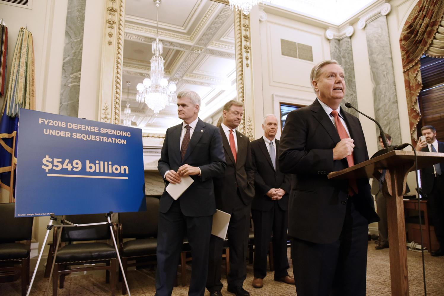 U.S. Sen. Lindsey Graham (R-S.C.) speaks as Sen. Bill Cassidy (R-La.), Sen. Dean Heller (R-Nev.), Sen. Ron Johnson (R-Wis.) listen during a news conference on health care on Wednesday, Sept. 13, 2017 on Capitol Hill in Washington, D.C. (Olivier Douliery/Abaca Press/TNS)