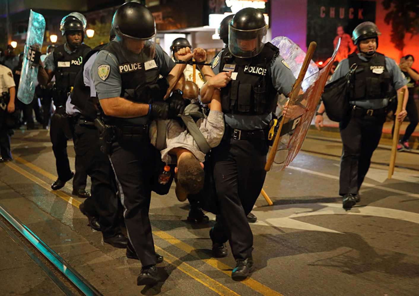 Police officers arrest a man during a confrontational protest on Delmar Boulevard in University City on Sept. 16, 2017. (David Carson/St. Louis Post-Dispatch/TNS)