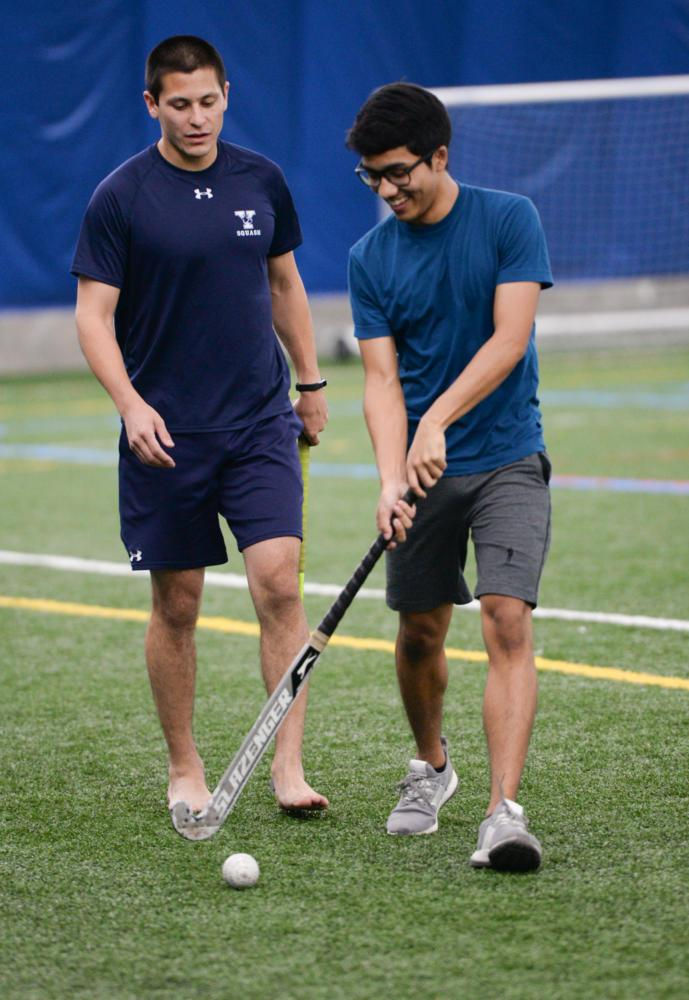 Brett Andrews (left) and Nikhil Khongbantabam practice at the Pitt Sports Dome on Monday evening.  (Photo by Sarah Cutshall | Staff Photographer)