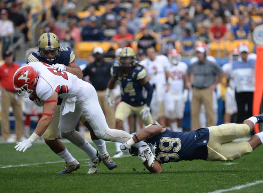 Pitt+linebacker+Saleem+Brightwell+%28%2339%29++and+Elijah+Zeise+%28%2325%29+tackle+YSU+player+in+Saturday%2C+Sept.+2%2C+game+against+the+Penguins.+%28Photo+by+Anna+Bongardino+%7C+Assistant+Visual+Editor%29++++