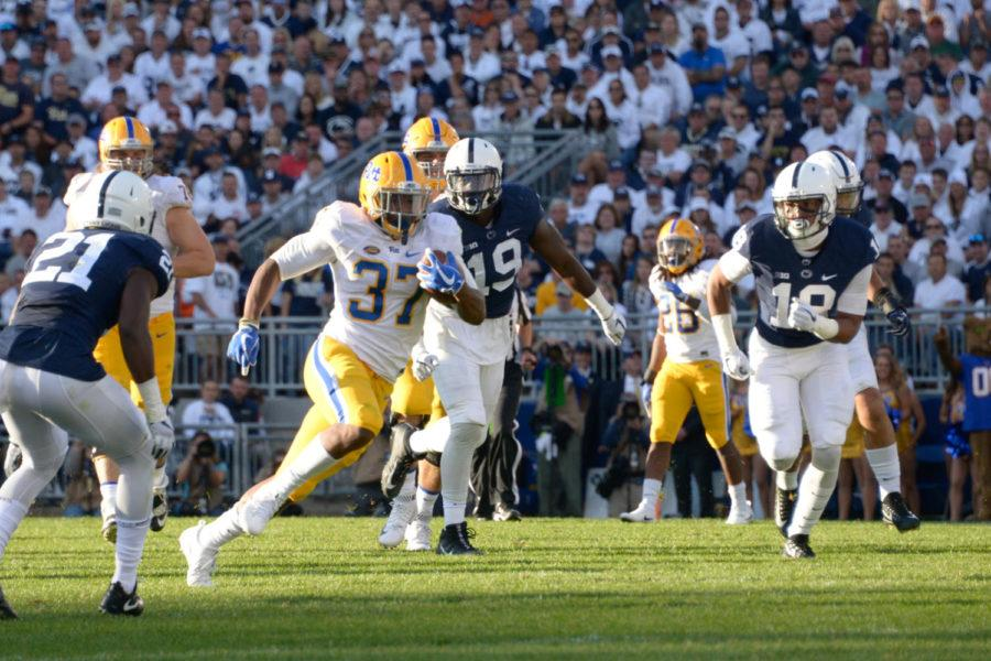 Running back Quadree Ollison rushes in the PSU game last Saturday. (Wenhao Wu / Assistant Visual Editor)