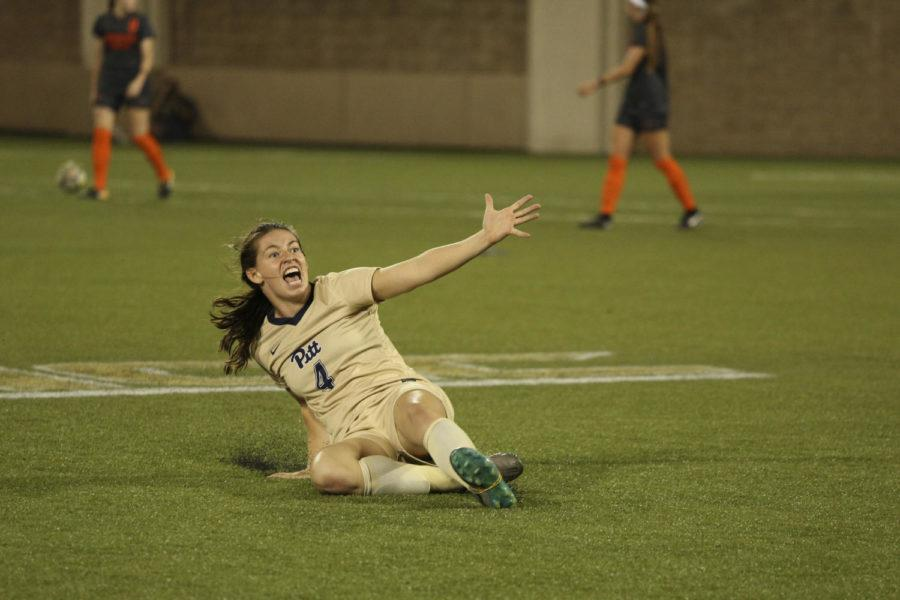 Mikayla Schmidt celebrates after scoring in the 72nd minute to tie the Thursday night game against Virginia Tech 1-1. (Photo by Thomas Yang | Staff Photographer)