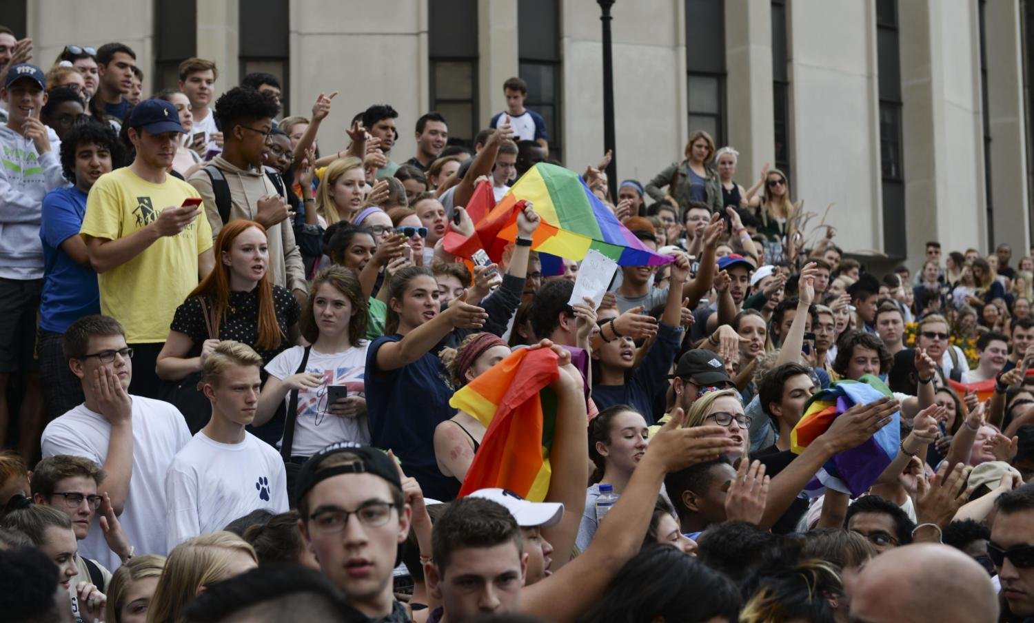 Students hold pride flags and chant at protesters across from Towers. (Photo by Wenhao Wu | Assistant Visual Editor)