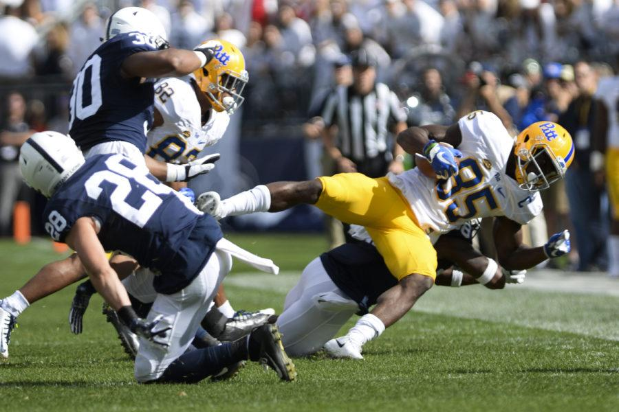 Penn+State+players+bring+down+Pitt+receiver+Jester+Weah+in+the+first+half.+Pitt+lost+to+PSU+33-14.%0A+%28Photo+by+Anna+Bongardino+%2F+Assistant+Visual+Editor%29