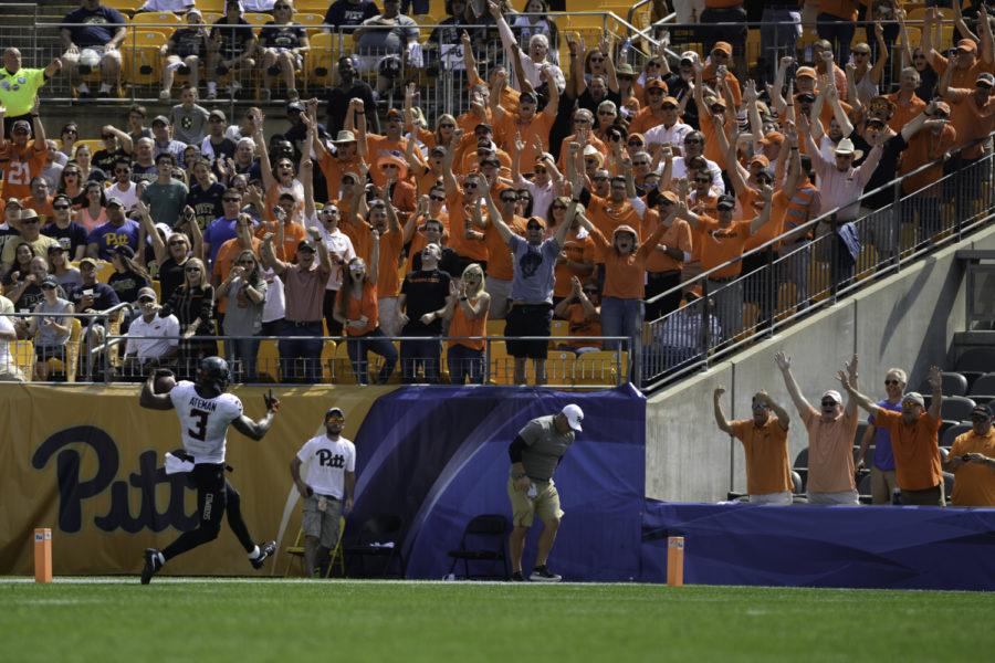 OSU+fans+cheer+as+receiver+Marcell+Ateman+scores+a+touchdown+in+the+first+half+of+Pitt%27s+59-21+loss.+%28Photo+by+John+Hamilton%29