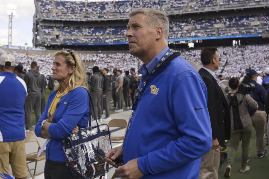 Pitt Chancellor Pat Gallagher and Athletic Director Heather Lyke stand on the field before the game. (Photo by Wenhao Wu / Assistant Visual Editor)