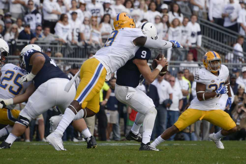 Dewayne Hendrix, pictured here sacking Penn State quarterback Trace McSorley in 2017, was signed by the Miami Dolphins as an undrafted free agent. (Photo by Wenhao Wu / Assistant Visual Editor)