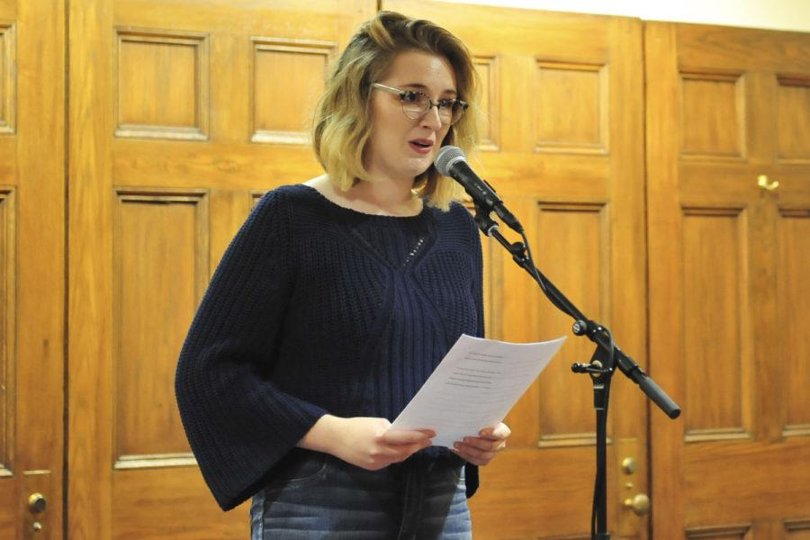 Alex Dolinger, a first-year psychology major, shares her mental health story at Stay Spoke Poetry Night in Nordy's Place. (Photo by Roger Tu | Staff Photographer)